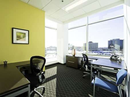 touch of yellow wall with a wide full glass window