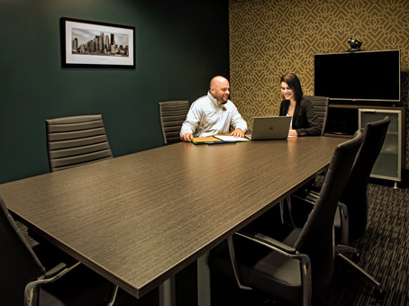 one on one meeting in a long table meeting room
