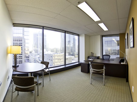 wide window office with an overlooking outside view