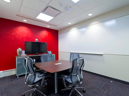 red & white color wall with a small office table