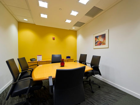 yellow & white wall with a yellow long table