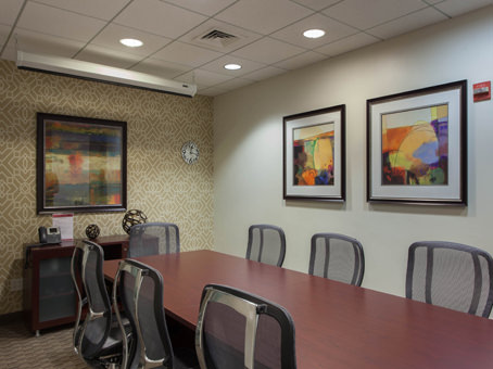 meeting room with a long table & chairs plus the painting on the wall