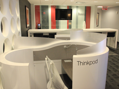 white thinkpod table and paintings