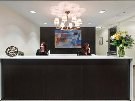 receptionist desks with flower vase