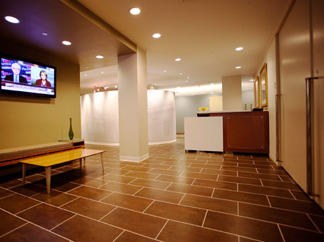 reception view with brown tiles flooring