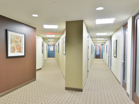 hallway with painting hanging on the wall