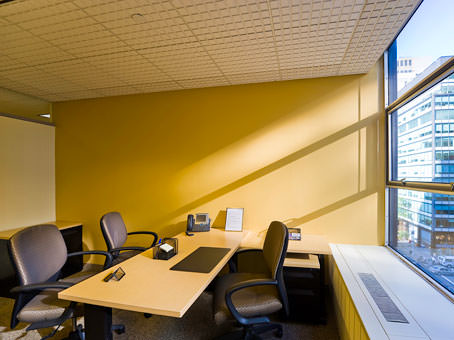 yellow wall in a full glass window office