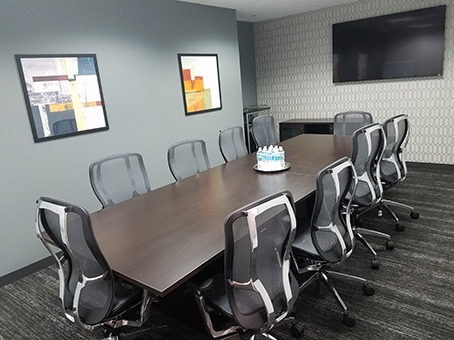 clean and clear meeting room with painting on the wall