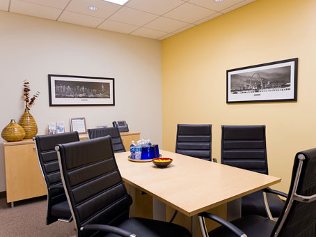a meeting room with rectangle shape painting on the wall