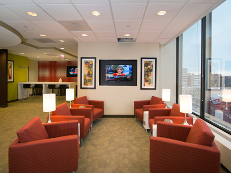 LED flatscreen Tv and red chair