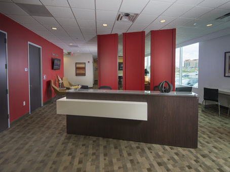 front reception desk with red accent wall