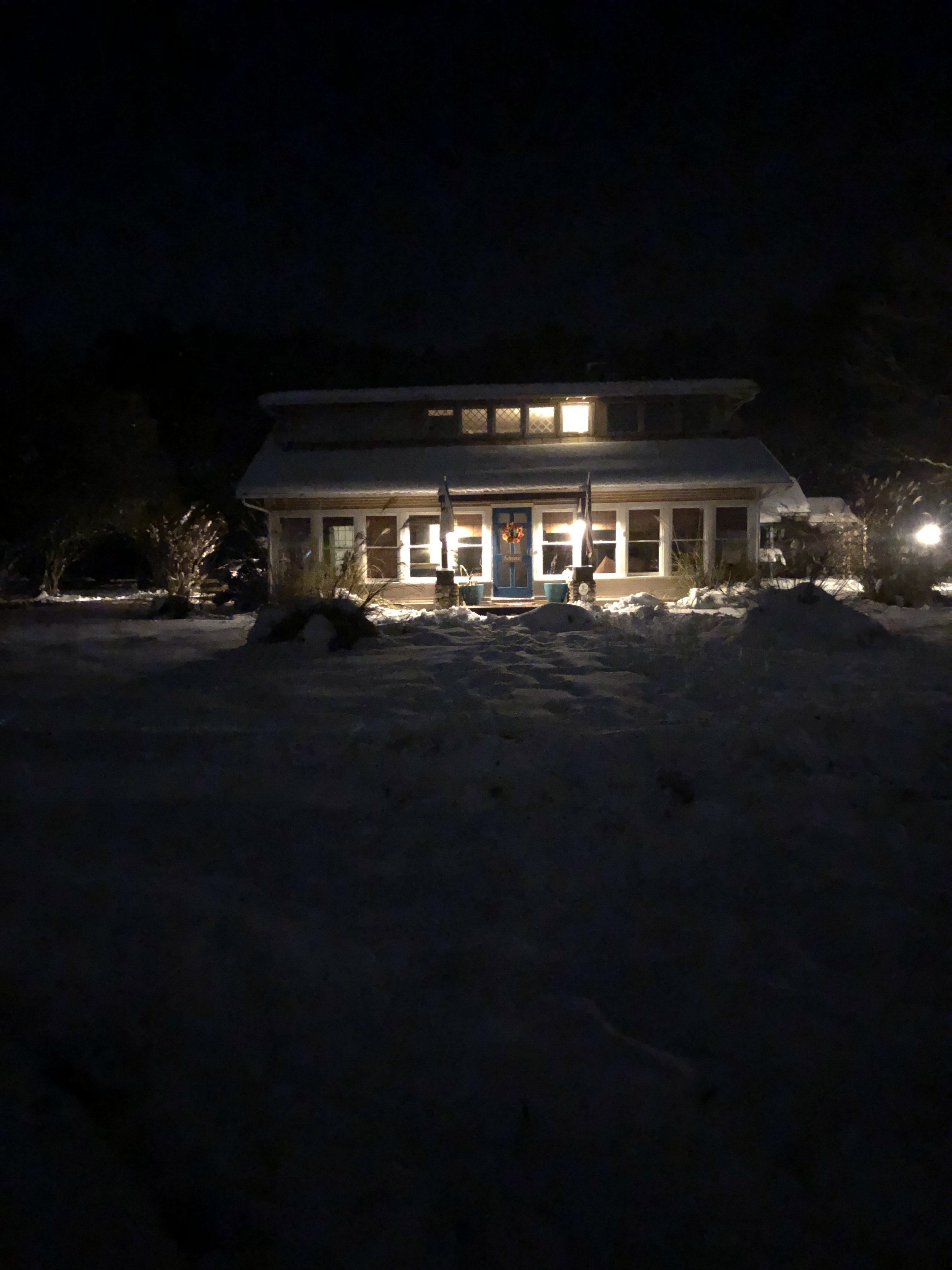 Our house in the snow at night :)