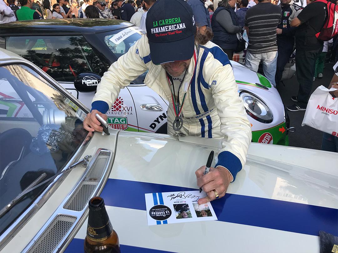 Chris signing autographs.