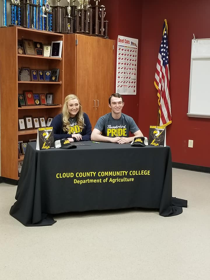 Youth members, Megan Olson and Colton Carter – first cousins – signed scholarships with the ag program at Cloud Community College, where they will compete in livestock judging beginning this Fall.