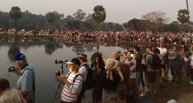 Tourist+hordes+at+sunrise+in+front+of+Angkor+Wat.jpeg