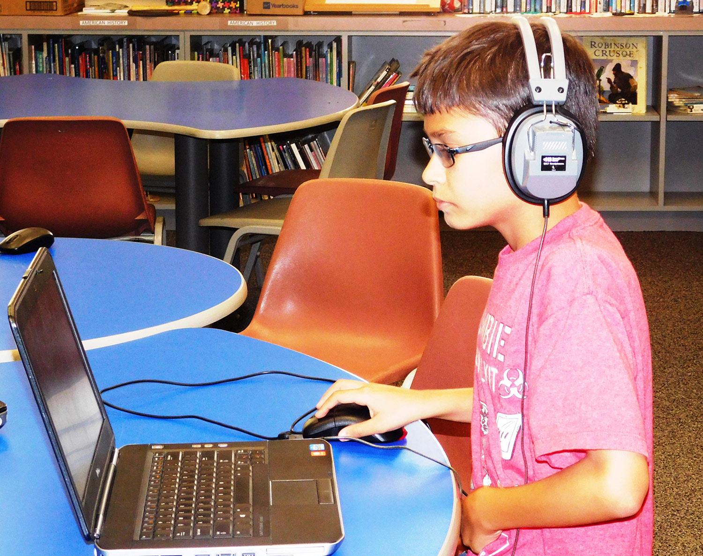 boy at laptop in headphones web.jpg