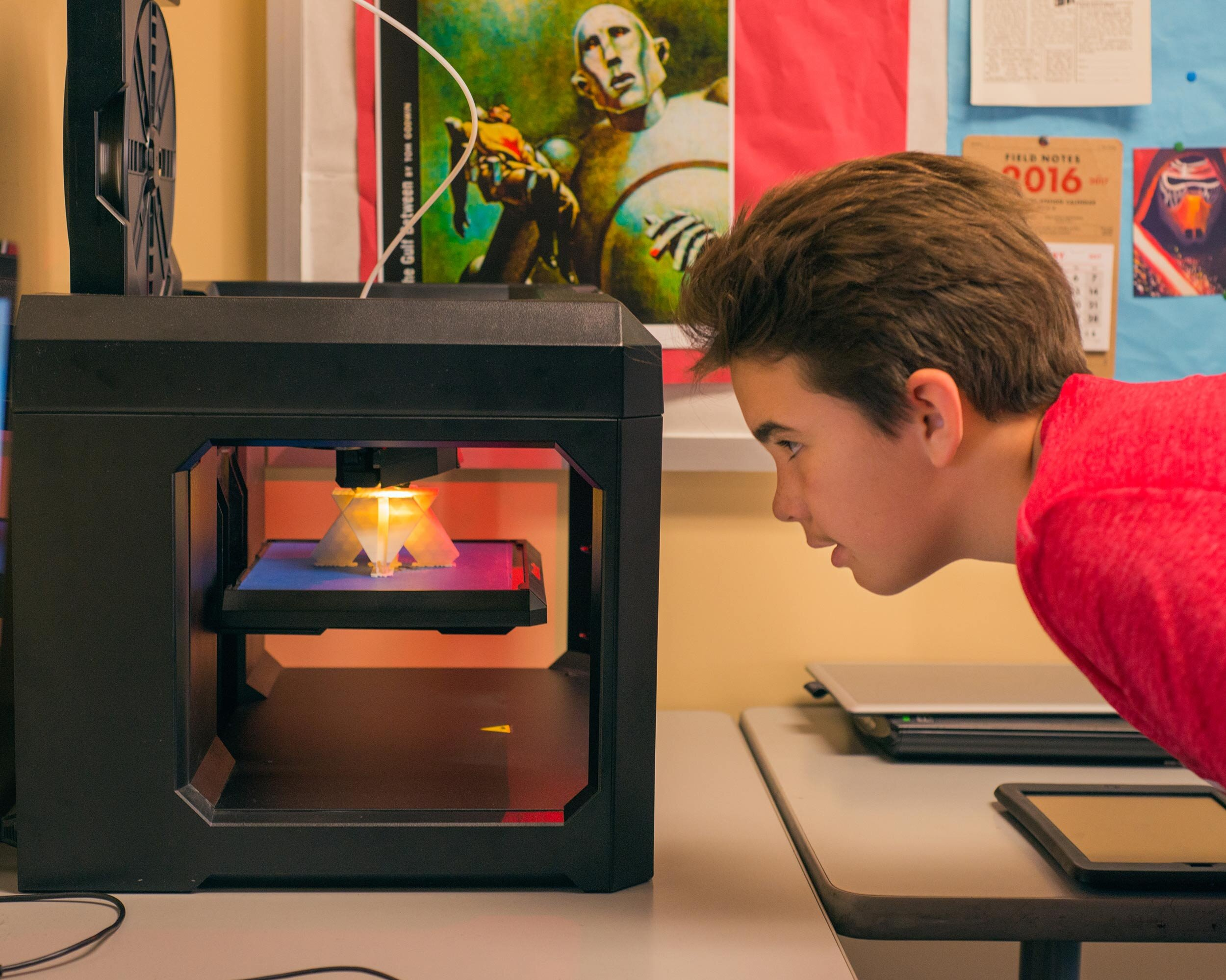 boy at 3d printer web.jpg
