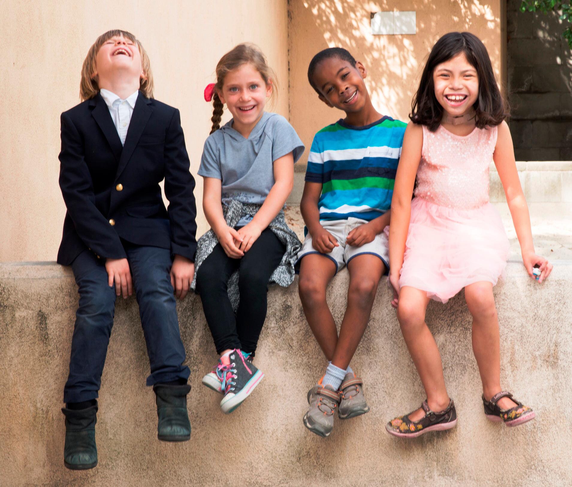playground-four kids on wall web.jpg
