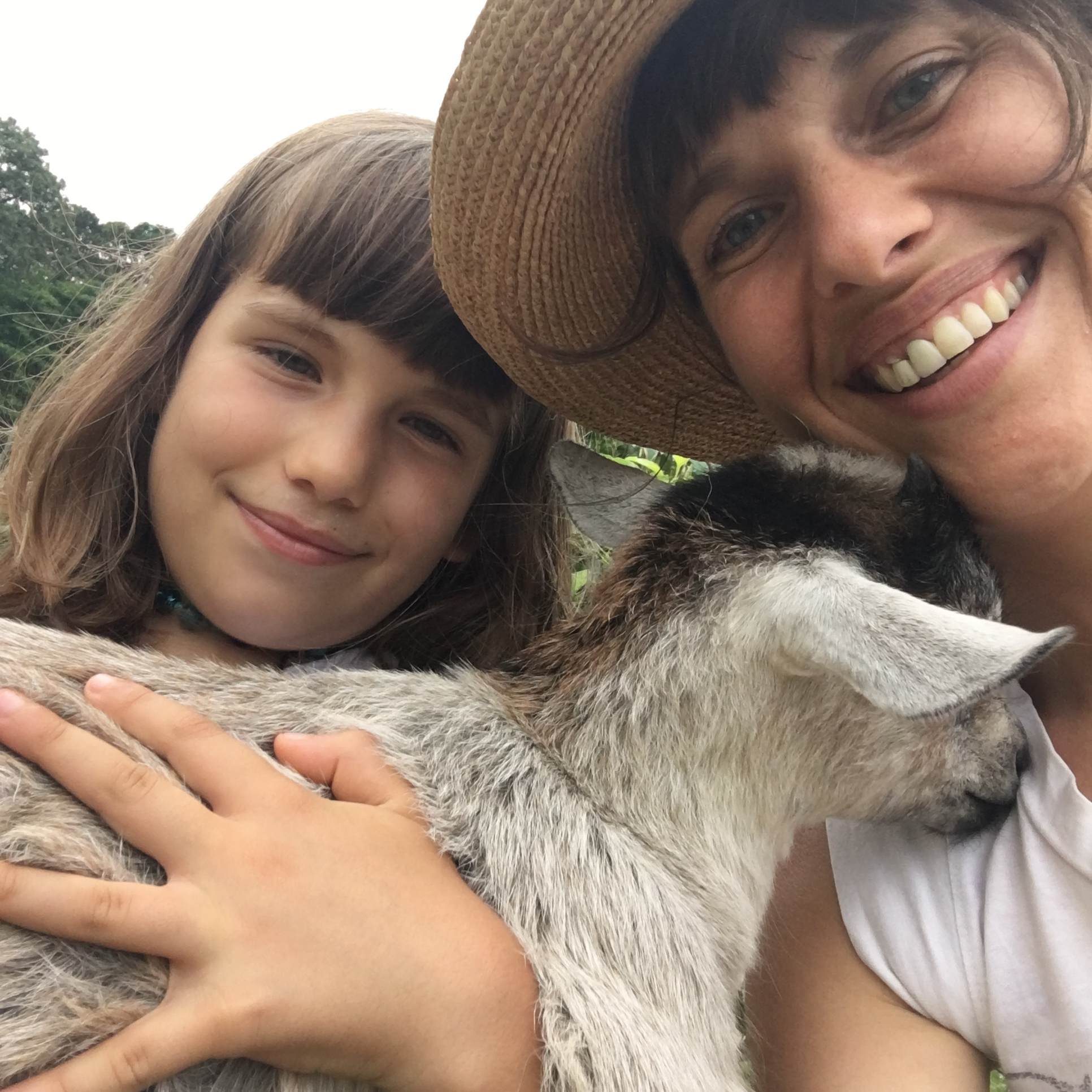 Éva with Lilla (age 7) and a super-sweet goat from  Native Earth Teaching Farm .