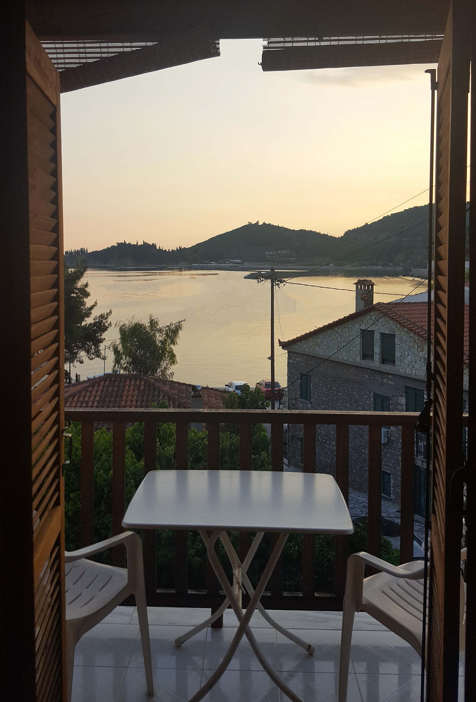 Monistiraki apartment balcony view with golden sea.jpg