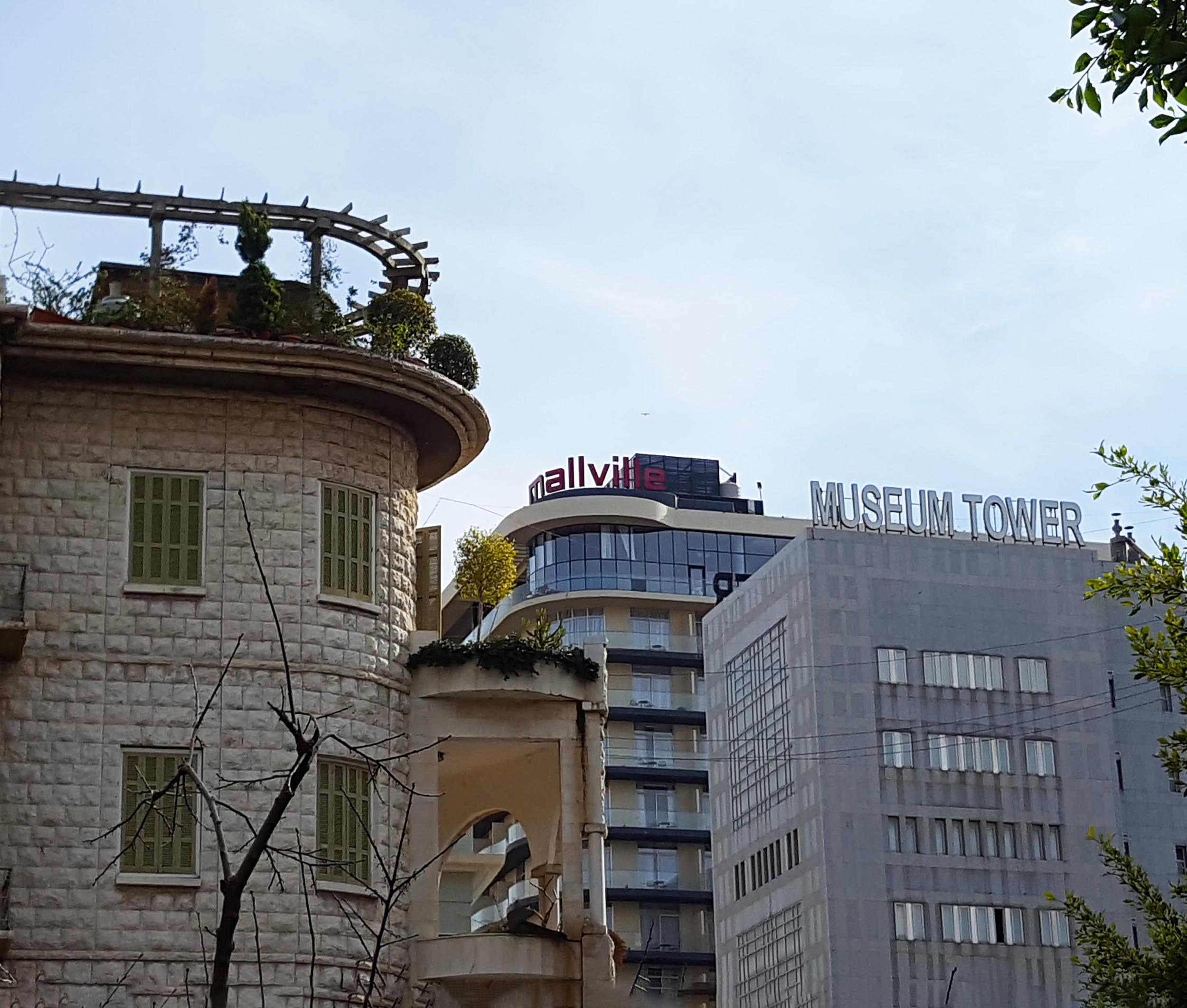 The Smallville sign wraps around the huge lookout corner. In Beirut, this is all too evocative of a sniper's nest sight - especially when you realise it's straight down the firing line from the  Maison Jaune .
