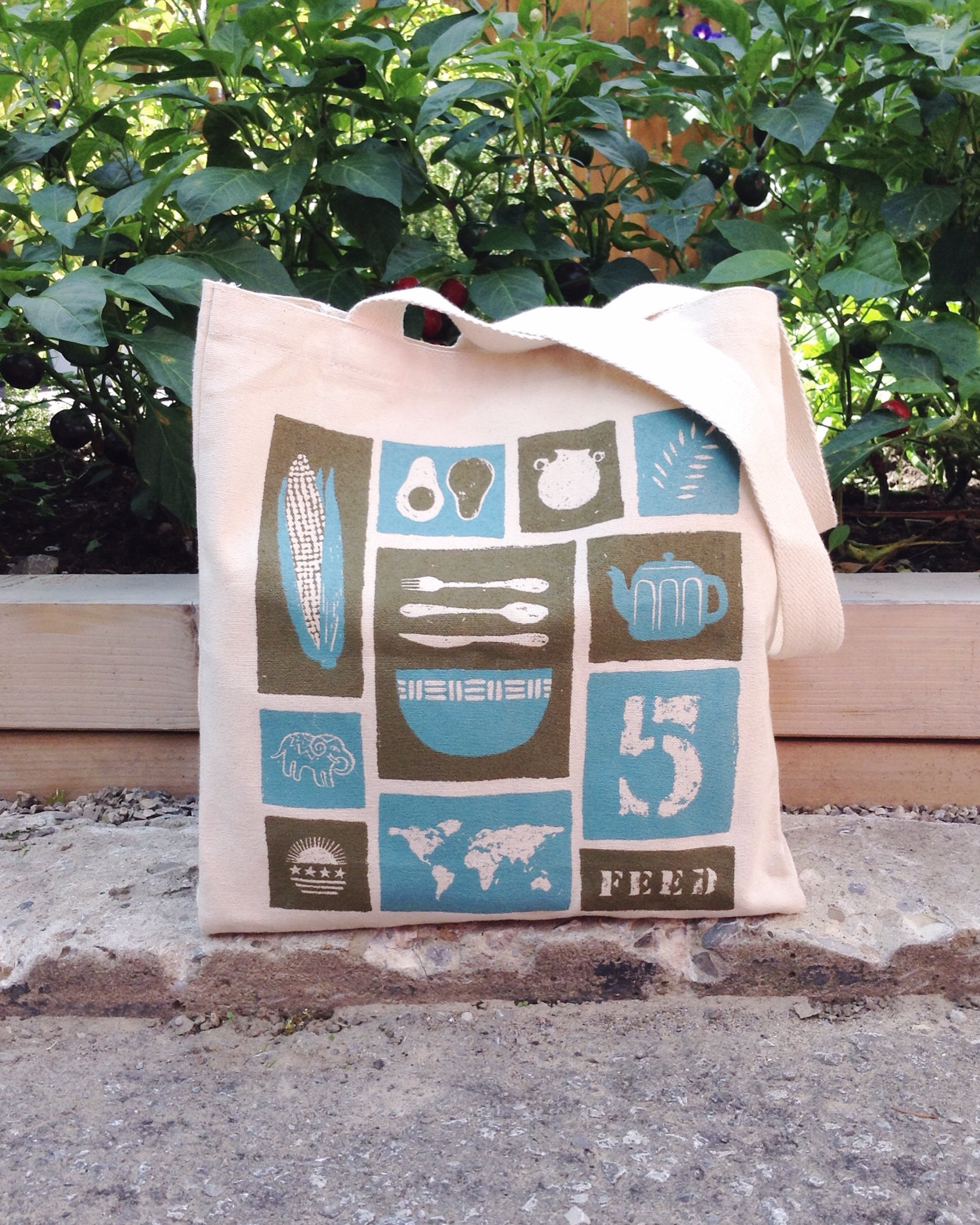 Screen-printed tote bag design for FEED Projects