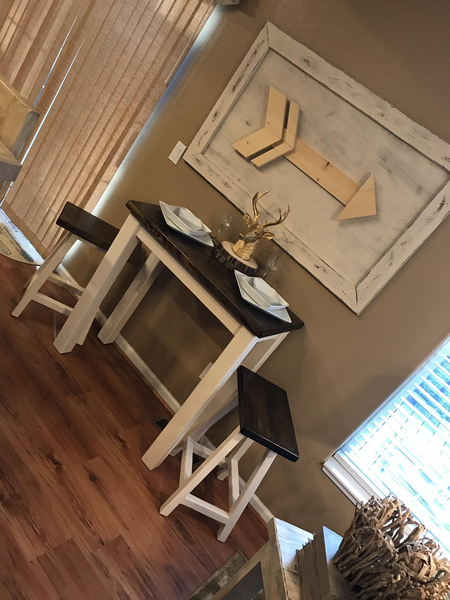 Bistro Table and Framed Arrow Wall Art
