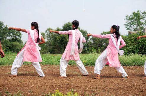 Image: Students giving a demonstration of the karate they have been taught as part of one of Ashta No Kai's initiatives; used for self-defence from eve teasing. Photo credit: Antoinette Louw, 2018.