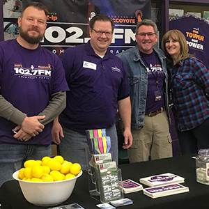 Jeremy Rock and Brian Watts with Mike and Jeanne Davis at the Kearney Business Expo.