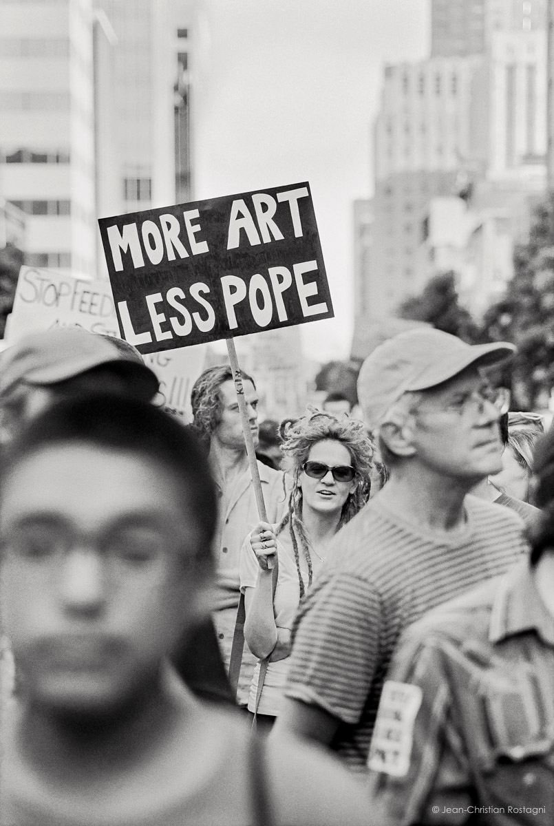 Jean Christian Rostagni. From one of the protest marches in Raleigh. Jean Christian has photographs from his extensive travels all over the globe. We have unframed images in different sizes of this and his other work.
