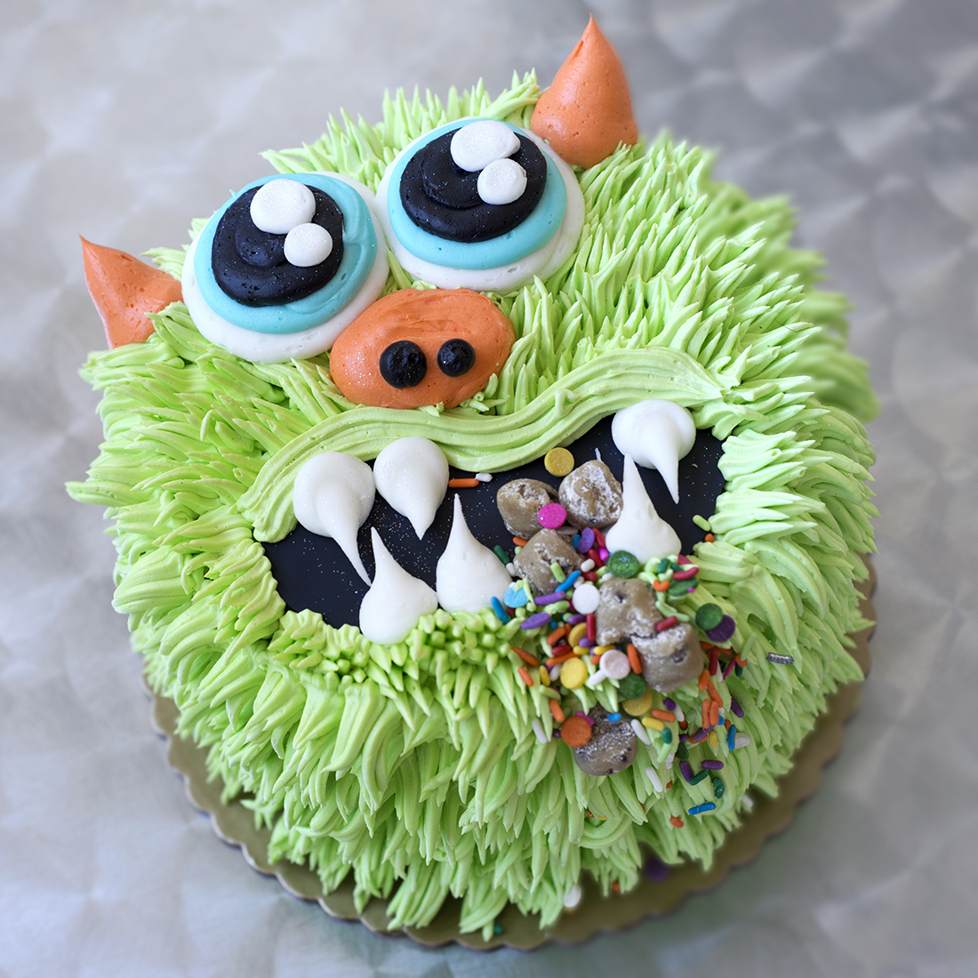 "Monster - Pick two colors to highlight. Fondant plaque included6""-$55, 9""-$95, 10""-$130, 12""-$180, Small Sheet-n/a, Large sheet: n/a"