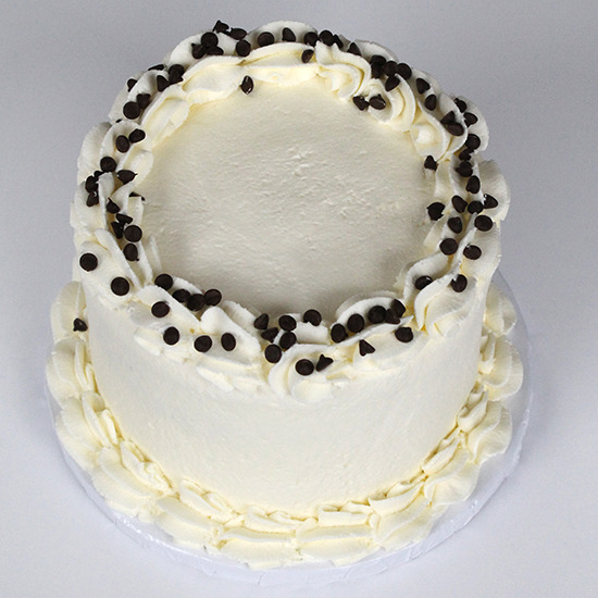 "Gluten Free Friendly Cannoli - Vanilla cake layered with our signature chocolate chip cannoli cream, vanilla buttercream frosting6"" $40 9"" 55 10"" 70 12"" 90"