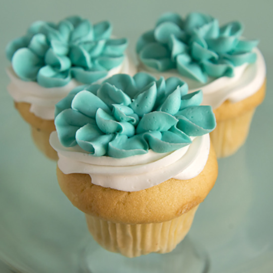 Floral - Buttercream flowers on the top of each cupcake: $4.00 each, minimum of one dozen per flavor and design.
