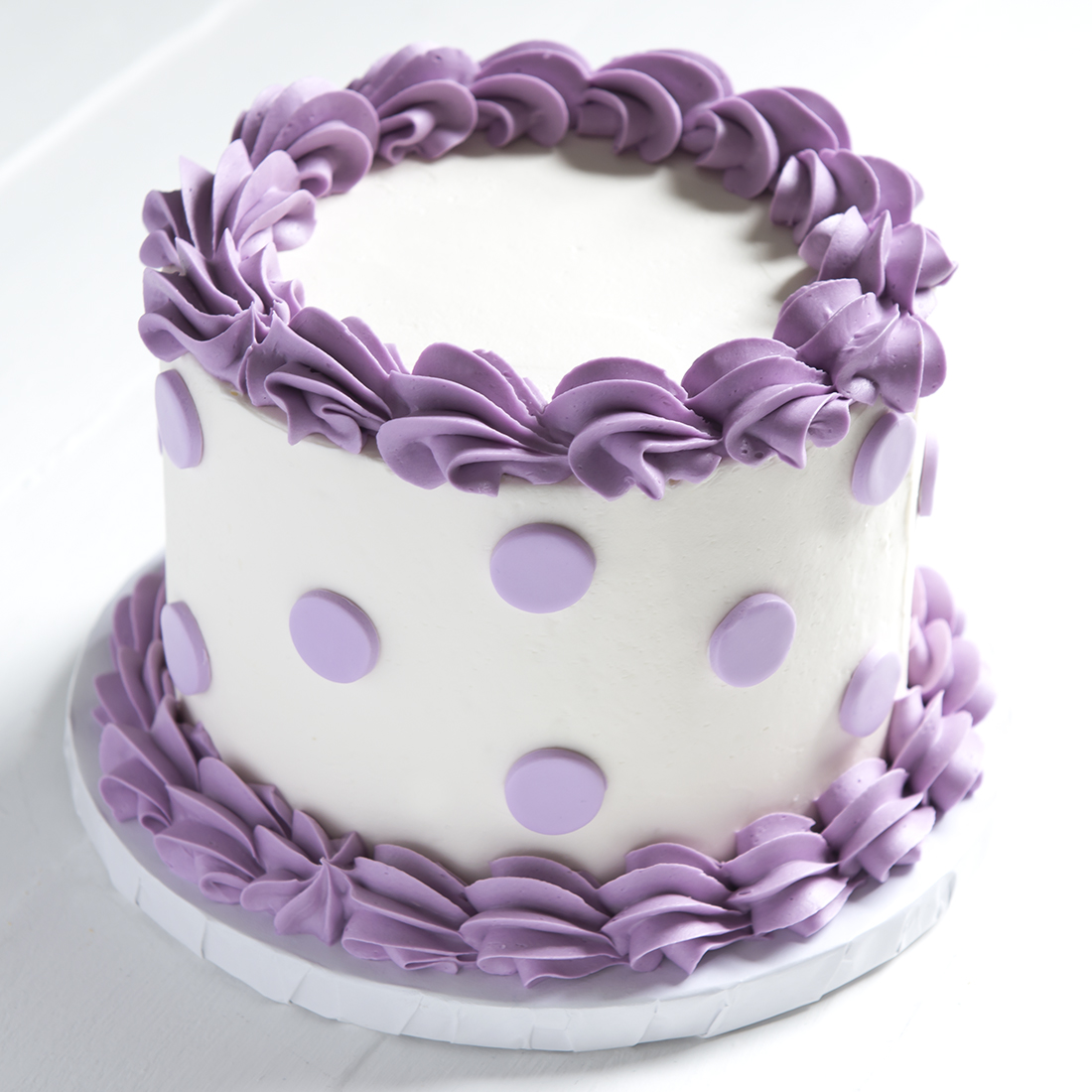 "Polka Dot - Vanilla buttercream frosting. Colored borders, colored fondant polka dots.6""-$55, 9"