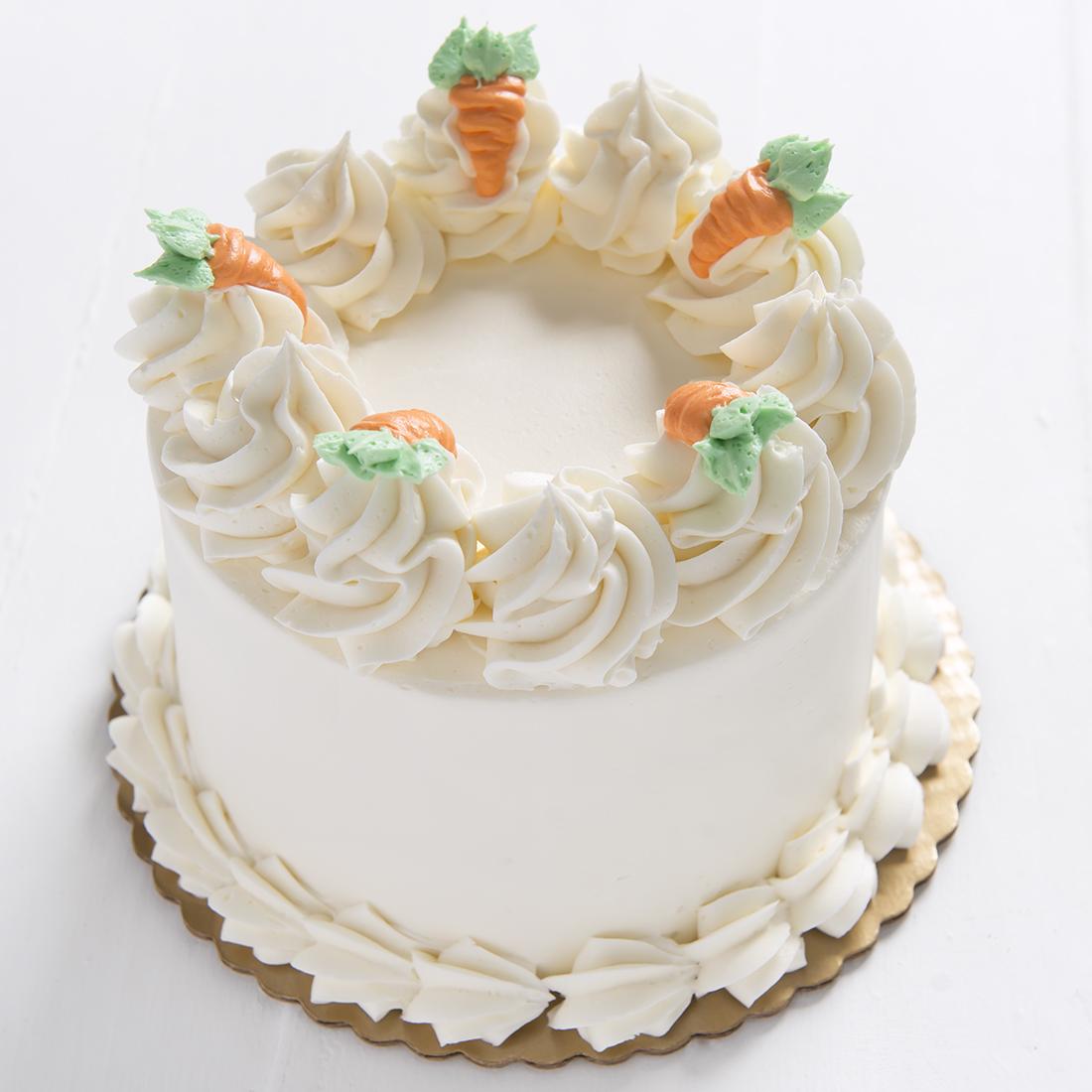 Carrot Cake - Carrot cake made with shredded carrots, coconut, pineapple, raisins & cinnamon, cream cheese filling, vanilla buttercream frosting6