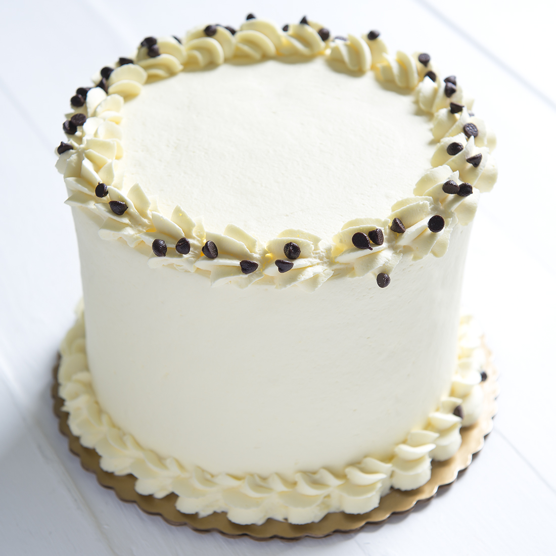Cannoli* - Vanilla cake layered with our signature Cannoli cream and mini chocolate chips, fresh whipped cream frosting6