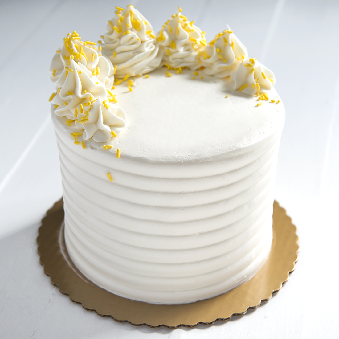 Lemon Drop - Lemon cake filled and frosted with lemon buttercream, yellow sprinkles6