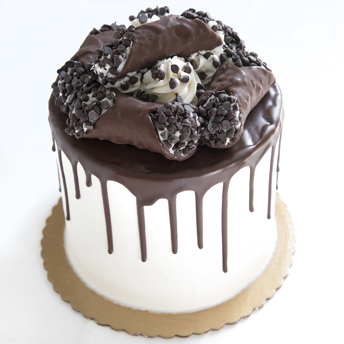 Holy Cannoli! - Vanilla cake layered with our signature chocolate chip cannoli cream, vanilla buttercream frosting, chocolate hazelnut 'drip', chocolate covered cannolis6