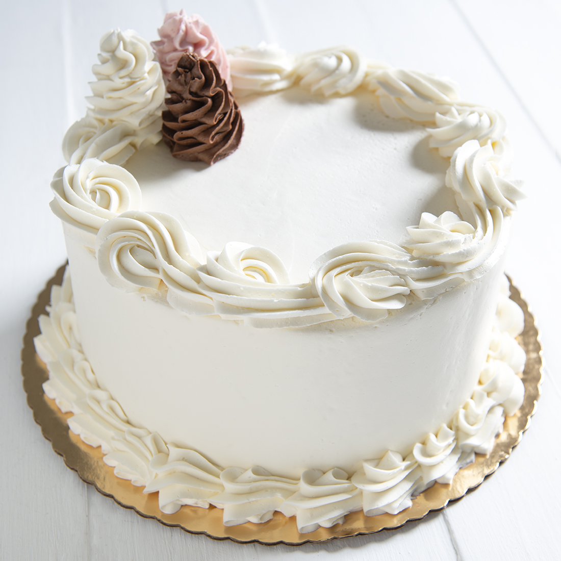 Neapolitan - One layer each of chocolate, vanilla & strawberry cake layered with chocolate & strawberry buttercream, vanilla buttercream frosting6