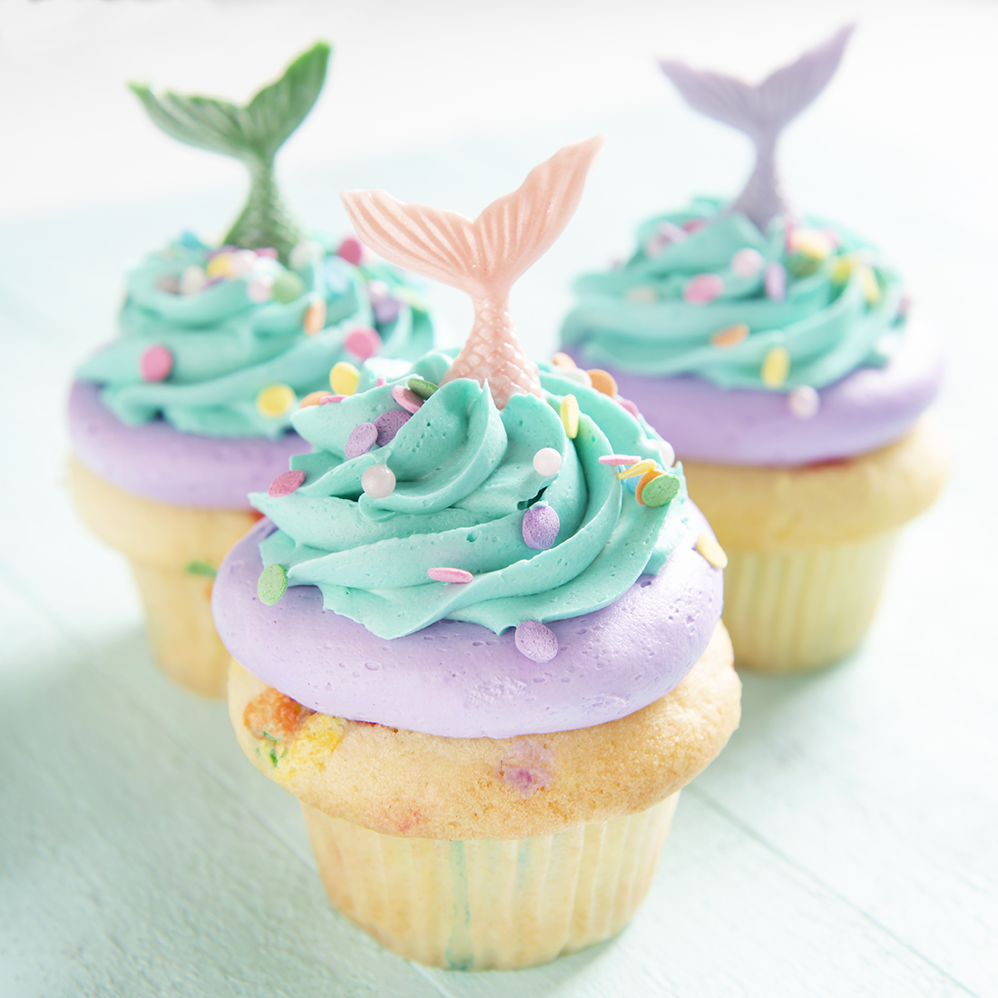Mermaids! - Vanilla, chocolate, lemon, almond or strawberry cupcake, vanilla buttercream frosting. White chocolate mermaid tails. Color of your choice: $5.00 each, minimum of one dozen per flavor and design.