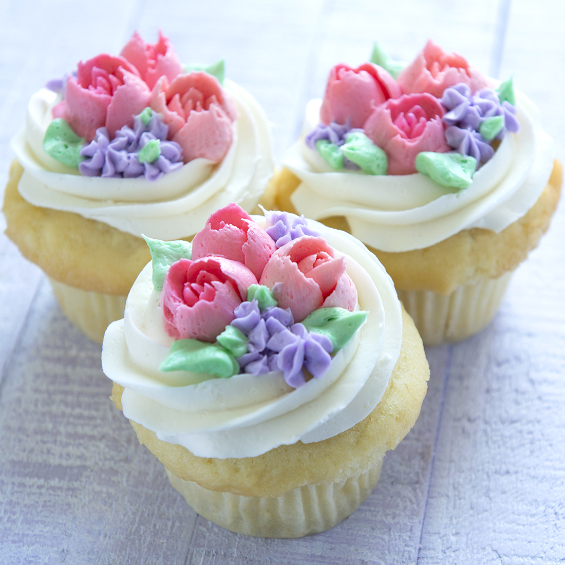 Garden Flowers - Buttercream flowers on the top of each cupcake: $4.00 each, minimum of one dozen per flavor and design.