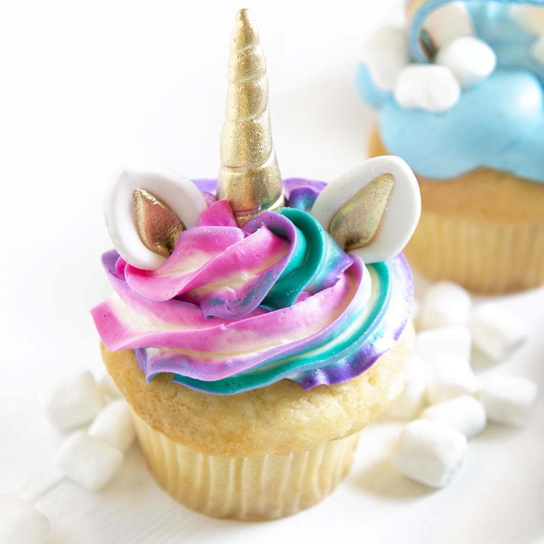 Unicorns - Vanilla, chocolate, lemon, almond or strawberry cupcake, vanilla buttercream frosting. Unicorn horn and ears. Color of your choice: $5.00 each, minimum of one dozen per flavor and design.