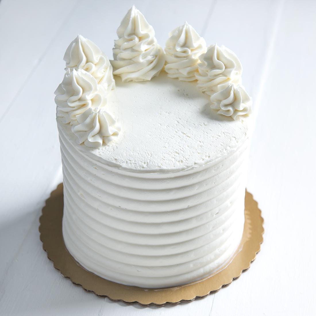 "Vegan Strawberry - Strawberry cake layered with strawberry buttercream, vanilla buttercream frosting6"" $40 9"" 55 10"" 70 12"" 90"