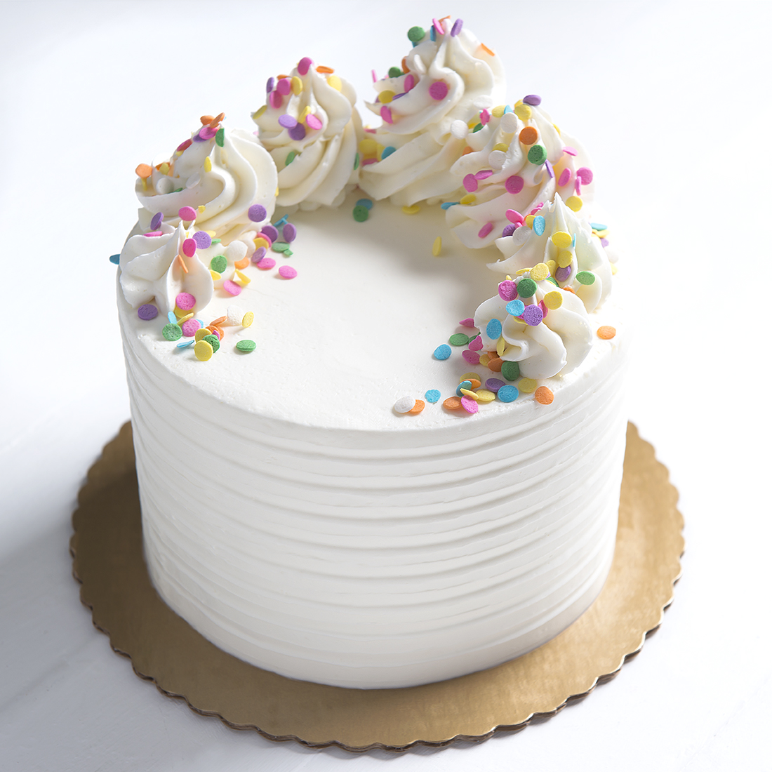 "Vegan Confetti - Confetti cake layered with vanilla buttercream & sprinkles, vanilla buttercream frosting, sprinkles6"" $40 9"" 55 10"" 70 12"" 90"