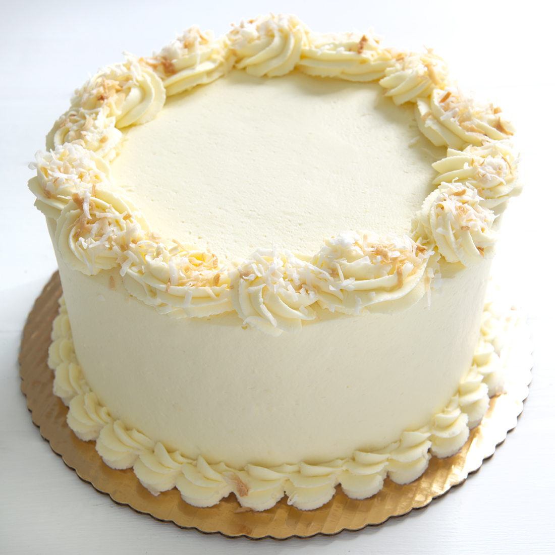 Coconut Dream* - Coconut cake layered with cream cheese filling, fresh whipped cream cheese frosting and sprinkling of toasted coconut6