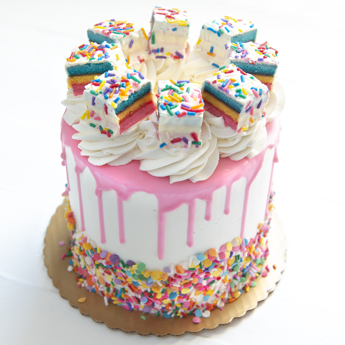Birthday Party - Confetti cake layered with vanilla buttercream and sprinkles, frosted in vanilla buttercream, white chocolate 'drip' in the color of your choice, mini birthday cake pieces, adorned with your choice of multi-color pastel or primary confetti sprinkles6