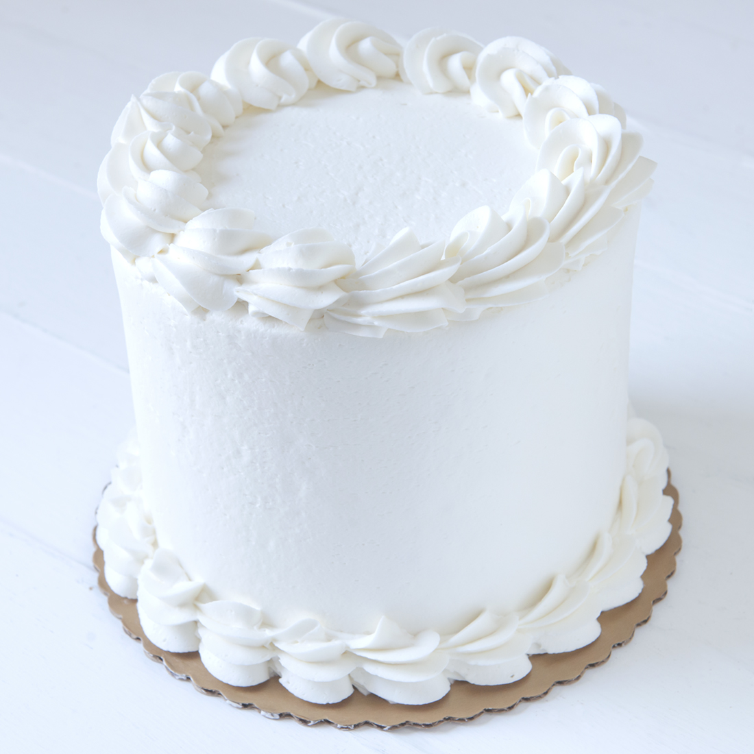 Vanilla Raspberry* - Vanilla cake, filled with raspberry jam filling, frosted with fresh whipped cream6