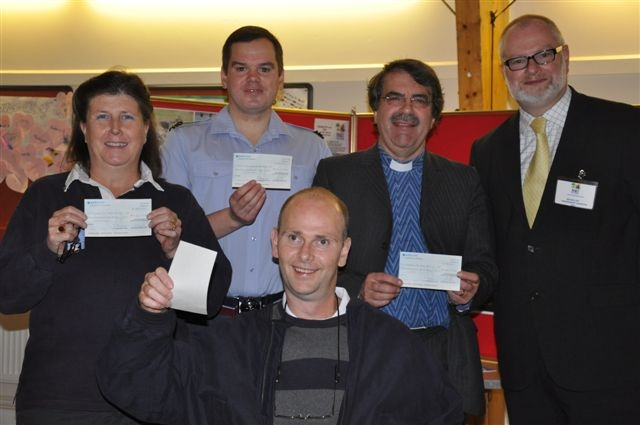 Picture of representatives of the recipient organisations with their cheques. Michael Day of the Feast Day organising committee is far right.