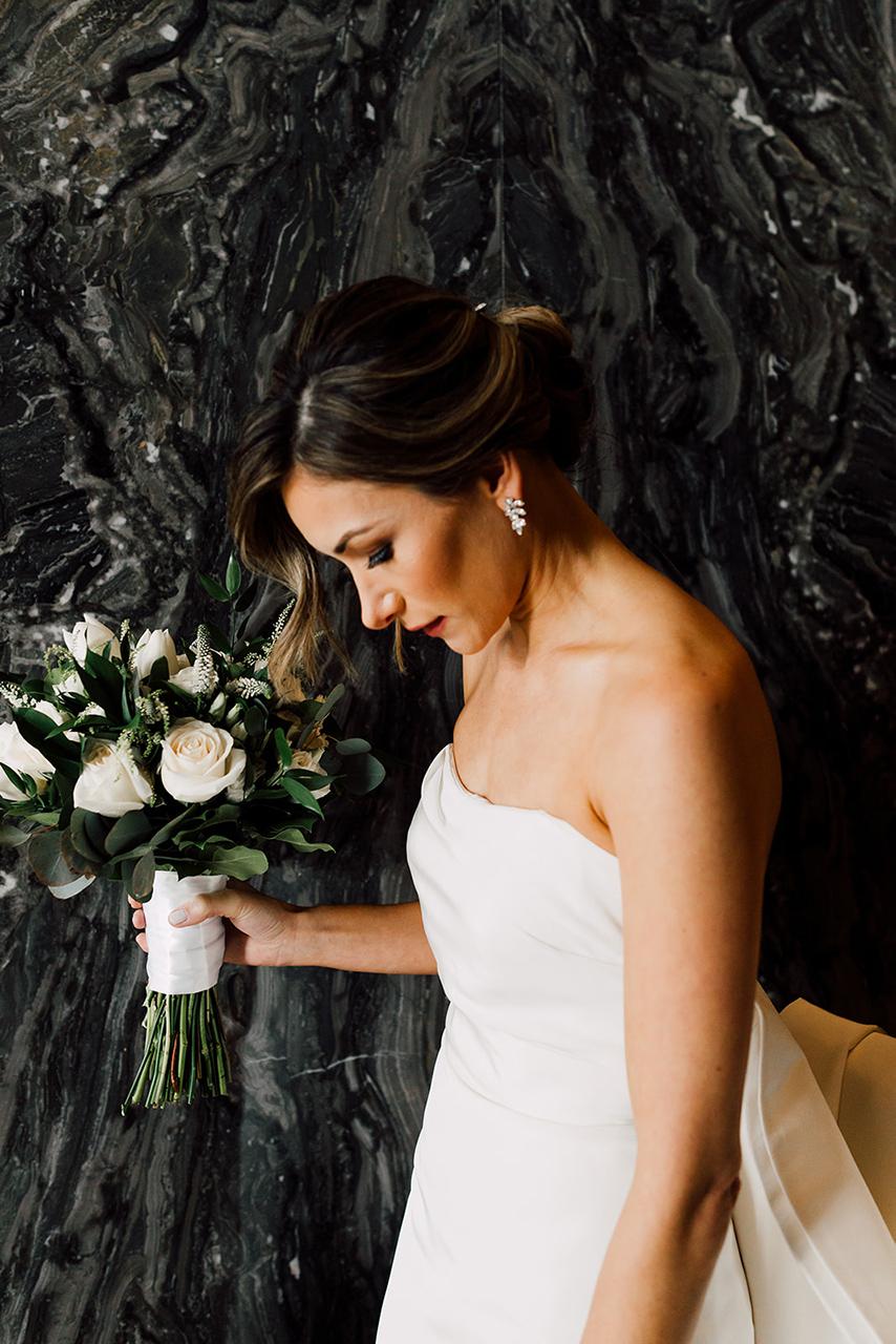 amora_beauty_studio_miami_bridal_makeup_woman_flowers.jpg