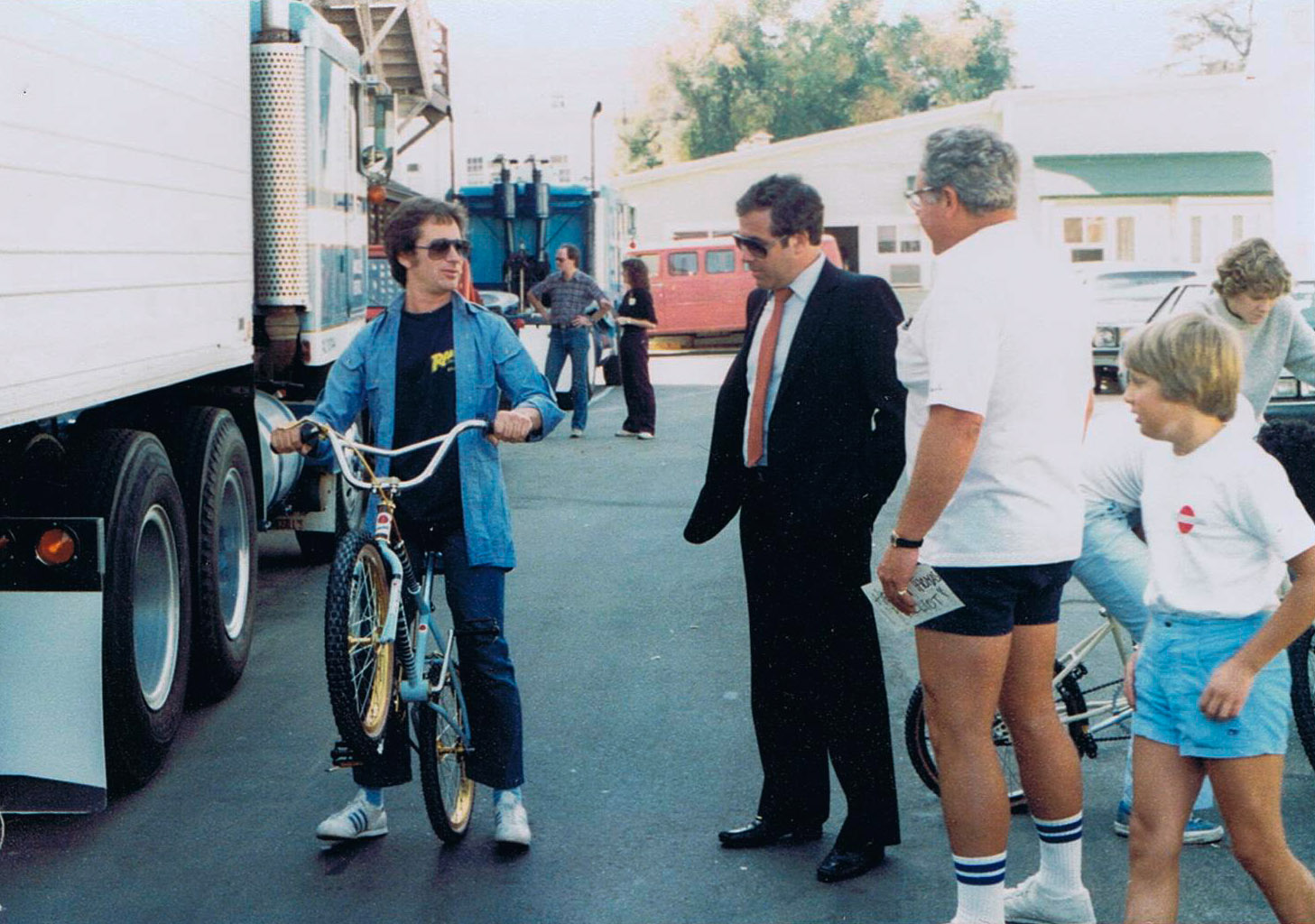 Steven Spielberg tests one of the bicycles delivered by Howie Cohen (in shorts) for use in the film E.T.   (photo courtesy of Howie Cohen)